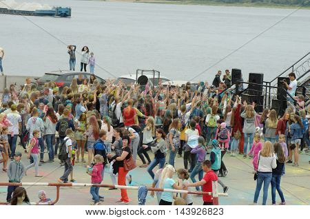 GORODETS, NIZHNY NOVGOROD OBLAST, RUSSIA - AUGUST 14, 2016: Group of young people celebrate festival of colors