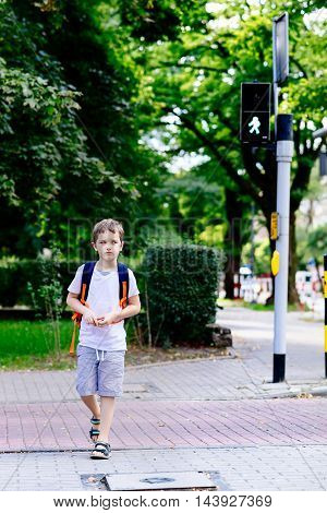 Little 7 Years Schoolboy Crossing Road On Green Light