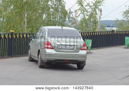 GORODETS, NIZHNY NOVGOROD OBLAST, RUSSIA - AUGUST 14, 2016: Nissan Tiida parked on city street.