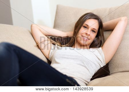 Young woman relaxing on her sofa