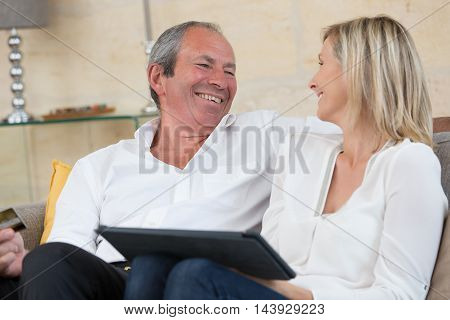 senior couple buying on internet at home