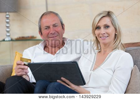 senior couple buying on internet with credit card