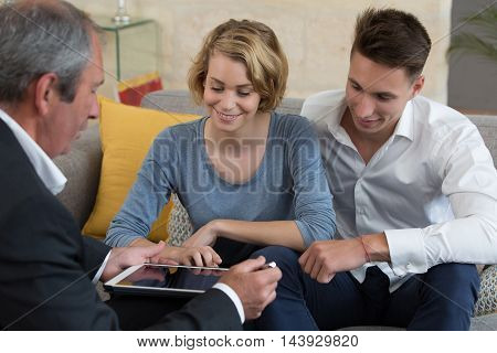 young couple meeting real-estate agent in house