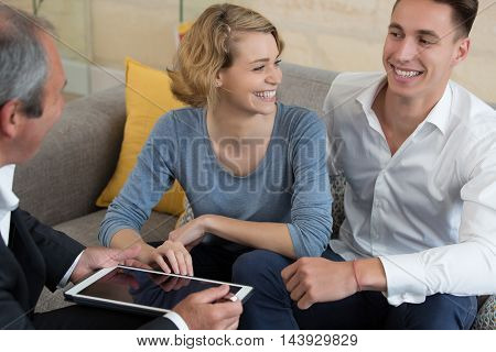 nice couple signing loan contract in house