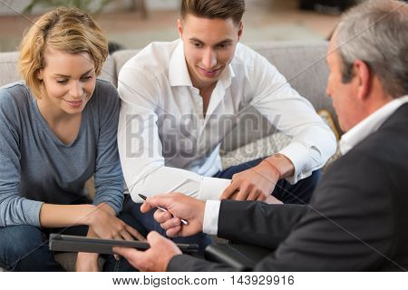 nice couple meeting financial adviser for investment