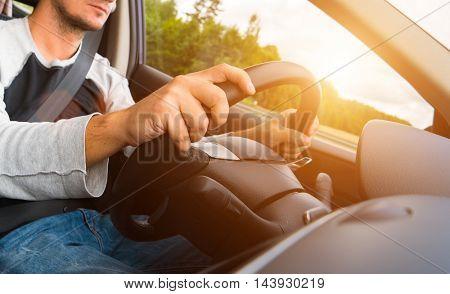 Young man driving his car