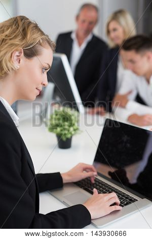 young business woman working in big office