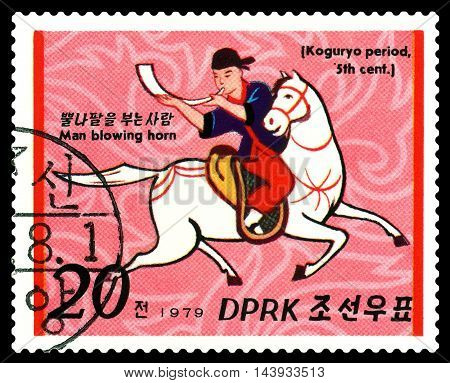 STAVROPOL RUSSIA - August 21 2016: a stamp printed in North Korea shows Man blowing horn Koguryo period 5th century cirka 1979