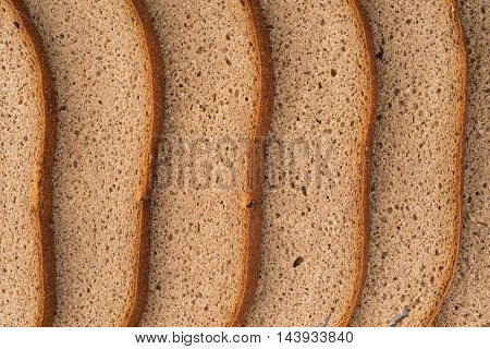 Background and texture rye bread close up. Top view.