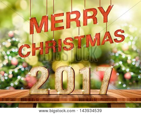 Merry Christmas 2017 (3d rendering) number on Brown Wood table top with abstract blur christmas tree background with bokeh lightHoliday Greeting card.