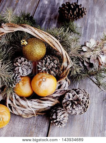 Christmas card with fir branches tangerines pine cones and decoration elements selective focus