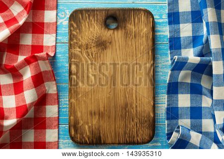 cutting board at wooden table