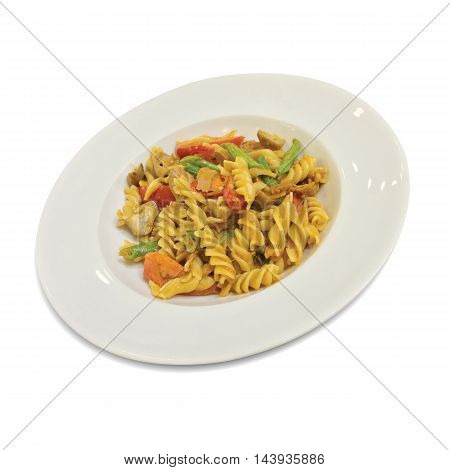 Fusilli with carrots and fresh tomatoes in dish isolated on background.