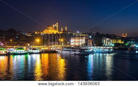ISTANBUL TURKEY - JUNE 20 2015: Night view on the Suleymaniye Mosque and Eminonu district Istanbul Turkey