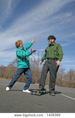 Senior Couple Having Fun W/Skateboard!