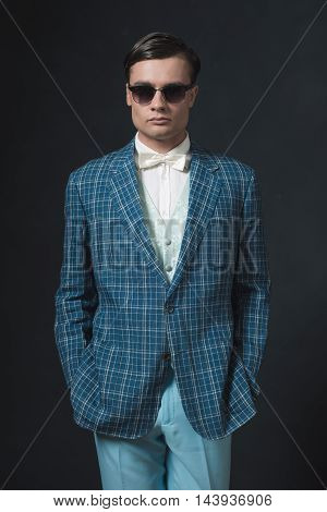 Sharp Dressed Young Man In Retro 1920S Style. Wearing Sunglasses.