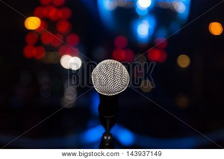 Microphone In Club On Background Of A Bright Lights