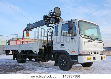 KEMEROVO RUSSIA - MAY 14 2015: great white truck crane standing on a construction site in winter