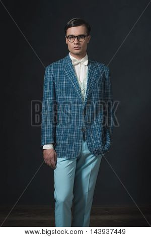 Retro 1920S Dandy Man Wearing Blue Checkered Jacket And Pants.