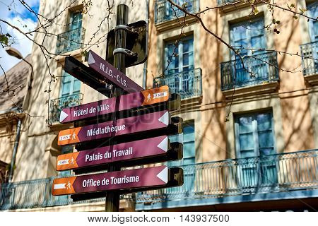 Narbonne France - April 8, 2016: Signpost showing directions to the different buildings and sights in the Narbonne city. Languedoc-Roussillon, France