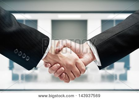 Businessmen shaking hands. Closeup. Partnership and cooperation concept