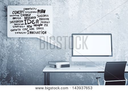 Creative workplace with empty computer monitor book coffee cup swivel-chair and abstract speech bubble with motivational words on concrete wall background. Mock up 3D Rendering
