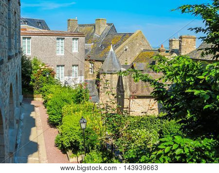 Street of Mont Saint-Michel, tidal island medieval town and abbey. France