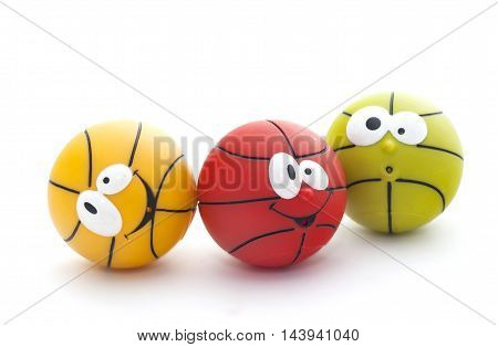 Three colorful toy basketball with faces isolated on a white background