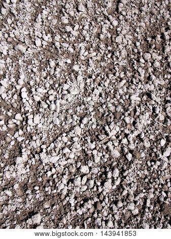 Wet grey and brown snady gravel background Melbourne 2016