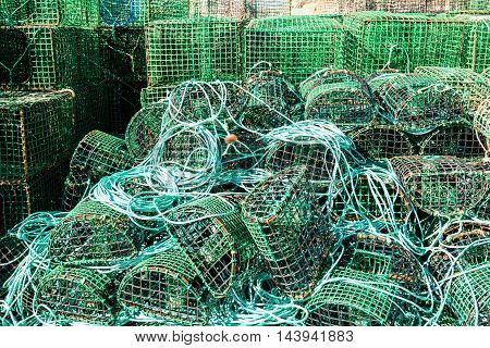Green traps for catching octopus and fish in the sea, close-up.