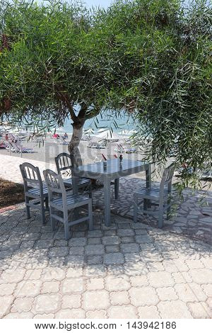 31ST JULY 2016, CALIS,TURKEY; A seating area of table and chairs along calis beach in turkey, 31st july 2016