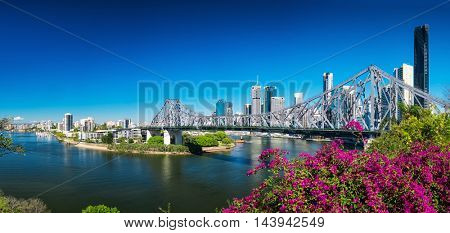 BRISBANE, AUS - AUGUST 9 2016: Panoramic view of Brisbane Skyline with Story Bridge and the river. It is Australias third largest city, capital of Queensland.
