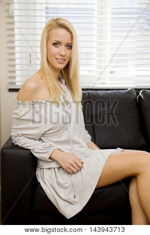 Portrait of a blond girl on a sofa
