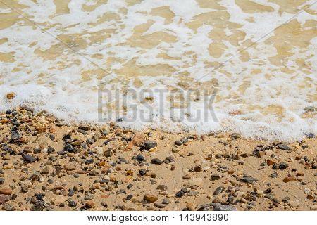 Ocean waves on the beach in summer.
