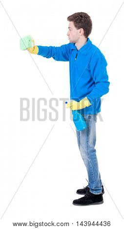 side view of a cleaner man in gloves with sponge and detergent. girl  watching.  view of person.  Isolated over white background. Curly boy in the blue jacket cleans.