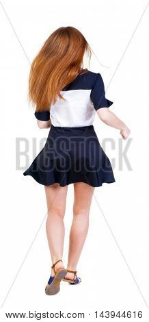 back view of running  woman in dress. beautiful redhead girl in motion. backside view of person.  Rear view people collection. Isolated over white background.