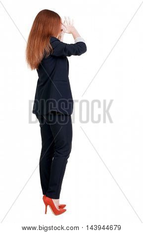 Back view of shocked business woman in suit. Upset businesswoman. Rear view people collection.  backside view of person.  Isolated over white background.