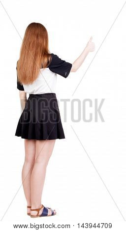 Back view of successful woman thumbs up. Rear view people collection. backside view of person. Isolated over white background. slender redhead in a dress shows hitchhiking