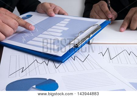 Professional Business Team Working Together At Office Desk Discussing A Meeting