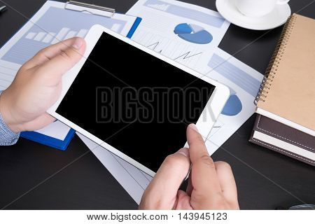 Modern People Doing Business, Graphs And Charts Being Demonstrated On The Screen