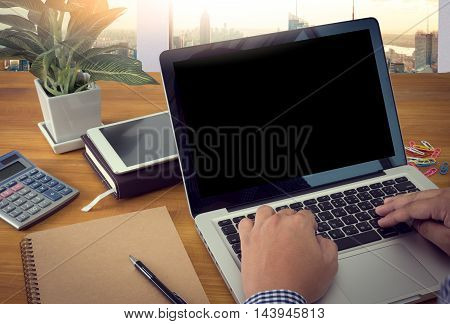 Close Up Of Business Man Hand Working On Blank Screen Laptop Computer On Wooden Desk