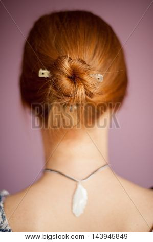 Hairstyle in a ponytail red-haired beautiful woman