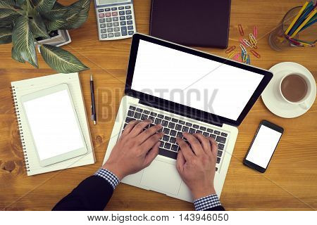 Corporate Identity Mock Up On An Hardwood Desk With Laptop, Tablet, Smartphone And A Cup Of Coffee