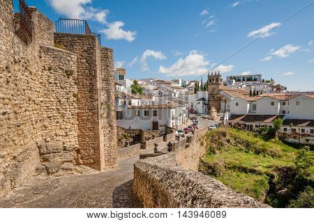 View from Felipe V Gate and view on the Nuestro Padre Jesus Church Ronda Spain.
