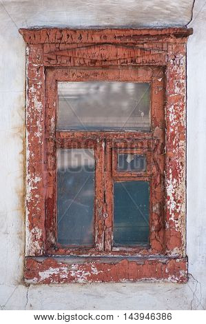 old brown window in the house close up.
