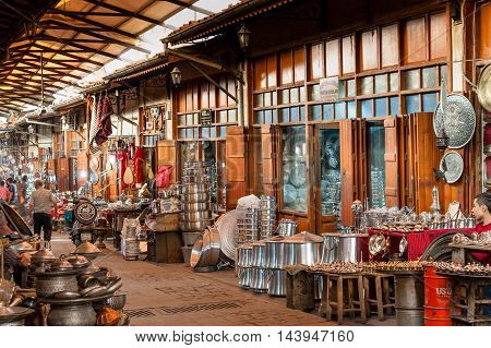 GAZIANTEP TURKEY - SEPTEMBER 24 2012: Coppersmith street in market bazaar of Gaziantep in Turkey. Copper and other metalwork produced to a high standard for decorations pots and ornaments.