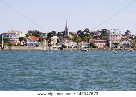 Arcachon Coast From A Boat Seeing The Notre Dame Basilique, France
