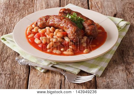 Pork Sausages With Beans And Cooked Tomatoes On A Plate Close-up. Horizontal