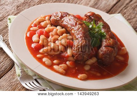 Grilled Sausage With Beans In Tomato Sauce On A Plate Close-up. Horizontal