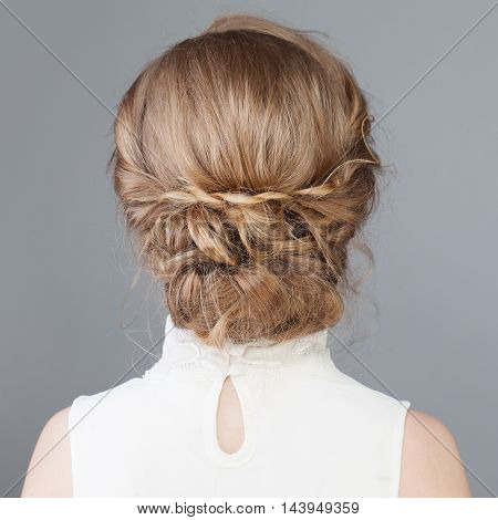 Female Back. Bridal or Prom Hairstyle on gray